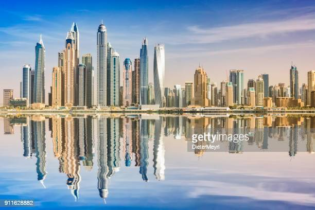 dubai skyline reflection, dubai marina, united arab emirates - skyline stock pictures, royalty-free photos & images