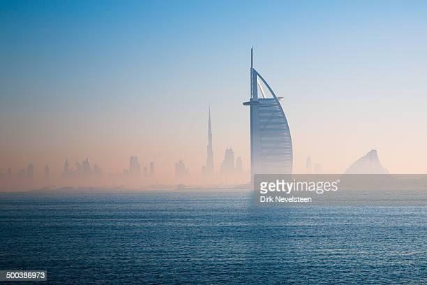 Dubai skyline seen in the morning from the Palm. Burj al Arab dominates over Burj Khalifa and Jumeirah Beach hotel.
