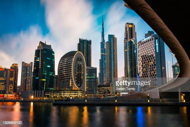 dubai skyline view from the marasi marina in city business bay downtown area in the uae - downtown stock pictures, royalty-free photos & images