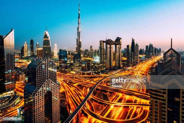 dubai skyline with traffic junction and burj khalifa - arabian peninsula stock pictures, royalty-free photos & images