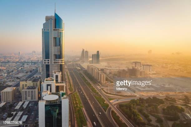 dubai sunrise over sheikh zayed road united arab emirates - mlenny stock pictures, royalty-free photos & images