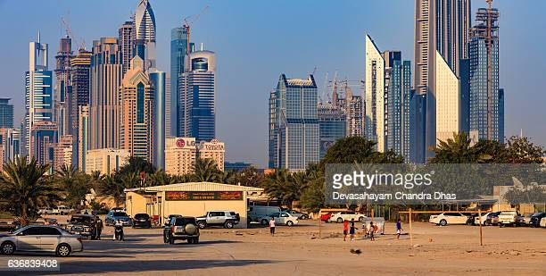 Dubai, UAE - Skyscrapers on Sheikh Zayed Road; Desert Foreground.