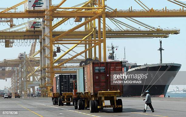 A cargo ship is docked at Jebel Ali port in Dubai 14 March 2006 Dubai Ports World owned by the United Arab Emirates government announced on 09 March...