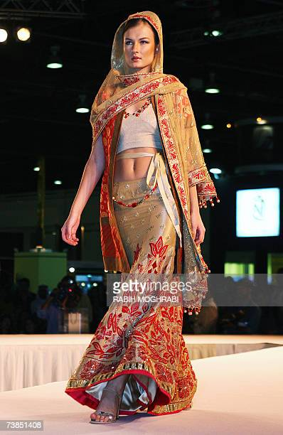 A model presents the work of Indian fashion designer Manish Malhotra during 'The Bride Show' in the Gulf emirate of Dubai 10 April 2007 AFP...