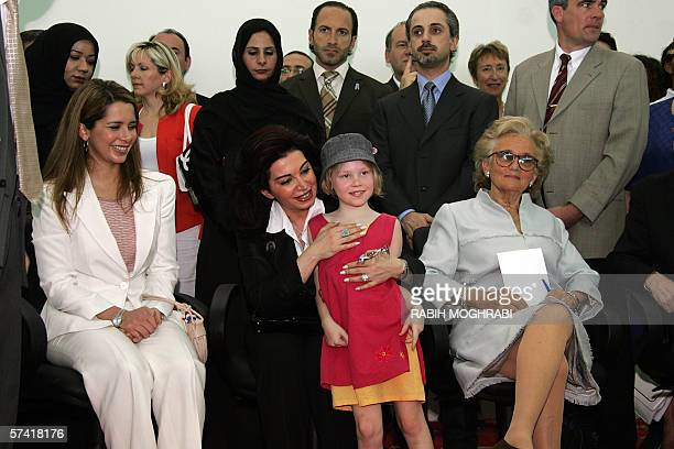 A school girls poses with French first lady Bernadette Chirac Princess Haya wife of General Sheikh Mohammed bin Rachid alMaktoum UAE Prime Minister...