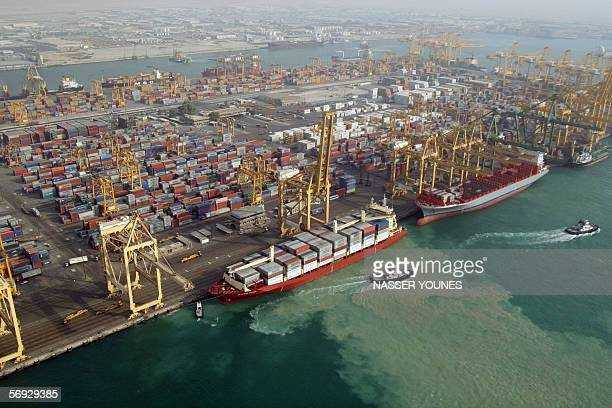 An Aerial view shows 24 February 2006 the Jebel Ali port a harbour with sixtyseven berths south of Dubai the world's largest manmade port The...