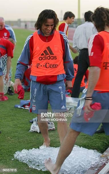 Dubai, UNITED ARAB EMIRATES: Bayern Munich midfielder Ali Karimi steps on ice cubes during a training session at the Al-Wasl Club in Dubai 10 January...