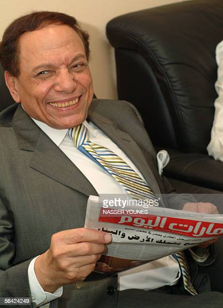 Egyptian comedy Star Adel Emam reads a copy of the United Arab Emriate's daily newspaper Emirates Today in Dubai 13 December 2005 Imam is attending...