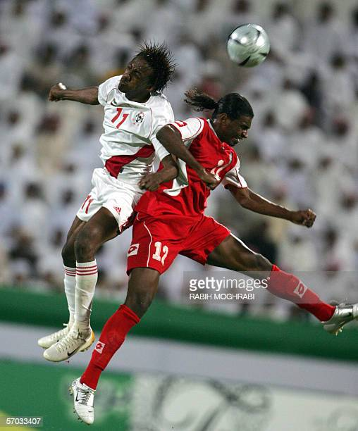 Emirati player Faisal Khalil jumps for the ball with Omani player Ahmed AlMahaijri during their national teams' Asian Cup 2007 qualifying match in...