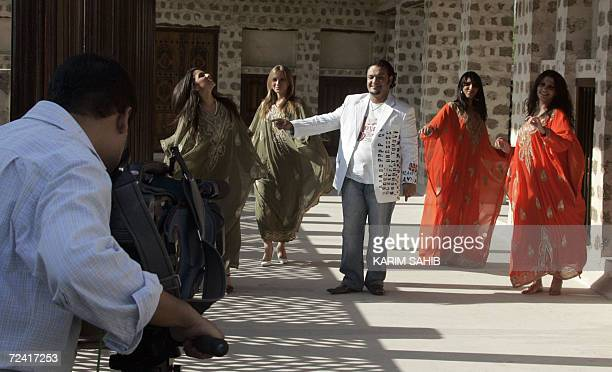 Exiled Iraqi singer Mohammed AlBaghdadi films his new videoclip in Dubai 05 November 2006 the same day ousted Iraqi president Saddam Hussein was...