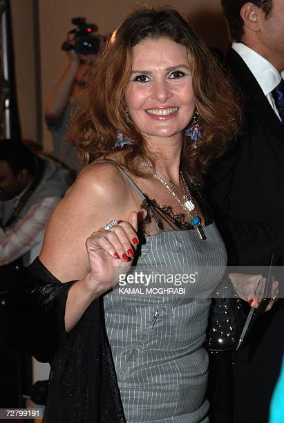 Famous Egyptian actress Yusra poses for pictures upon her arrival to the screening of Khiyana Shariah 'justified cheating' movie during the second...