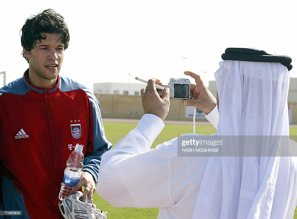 FILES -Picture taken 12 January 2006 shows an Emirati fan taking a picture of Bayern Munich player Michael Ballack after a training session at the Al-Wasel stadium in Dubai , during Bayern's third annual winter training camp in the United Arab Emirates. German football captain and new Chelsea midfielder Michael Ballack has been fined 60,000 euros for failing to declare a handbag he bought in Dubai at airport customs, a German newspaper said on 24 May 2006. Ballack bought the handbag, which is valued at about 2,000 euros, for his girlfriend in the shopper's haven in January and it was found in his luggage at Munich airport.