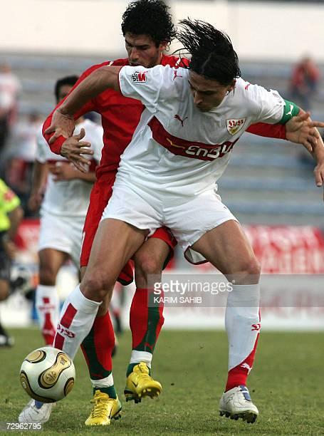 Iran's national football team player Javad Kazemein vies with VFB Stuttgart's captain Fernando Meira during their Challenge Cup 2007 match in Dubai...