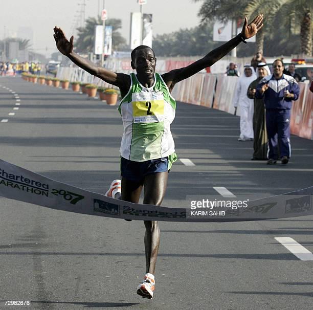 Kenyan William Todoo crosses the finish line during Dubai Marathon 12 January 2007 Todoo won the 42 Kms race with a time of 2h09min AFP PHOTO/KARIM...