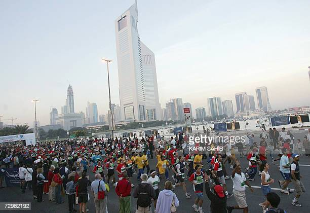 Participants compete in Dubai Marathon 12 January 2007 Willam Todoo of Kenya won the 42 Kms race with a time of 2hours 09min AFP PHOTO/KARIM SAHIB