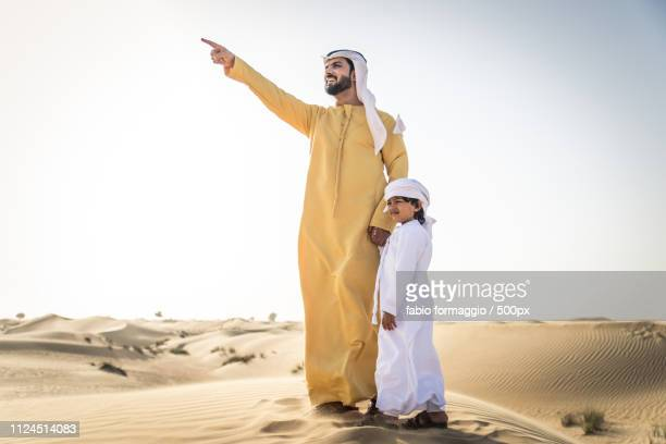 dubai, united arab emirates - two generation family stock pictures, royalty-free photos & images