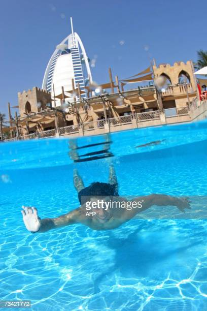 Rafael Nadal of Spain swims at the Wild Wadi waterpark in Dubai 24 February 2007 The tennis player is in the Gulf emirate to defend his title in the...