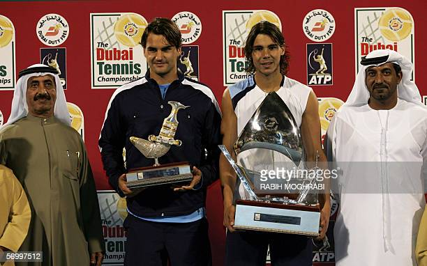 Rafael Nadal of Spain winner of ATP Dubai Open and Roger Federer of Switzerland in second place display their trophies next to Chairman of Emirates...