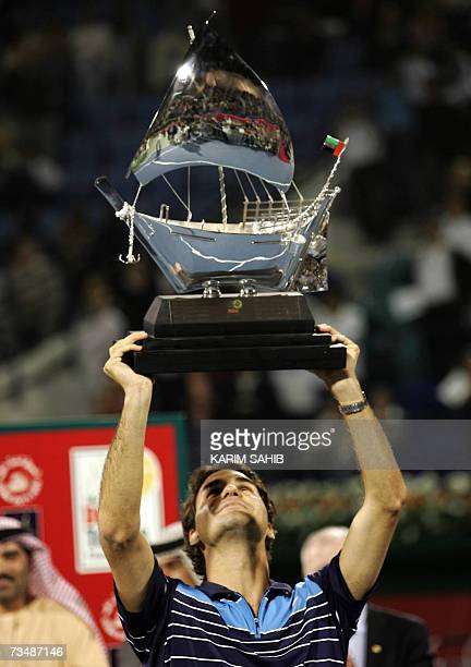 Roger Federer of Switzerland holds his trophy after beating Mikhail Youzhny of Russia in their final tennis match for the Dubai Duty Free Open 03...