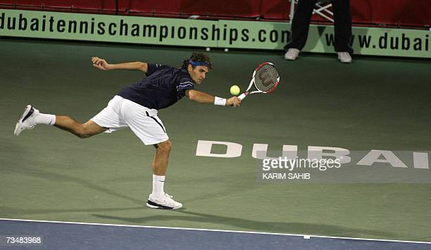 Roger Federer of Switzerland returns the ball to Mikhail Youzhny of Russai during their final tennis match for the Dubai Duty Free Open 03 March 2007...