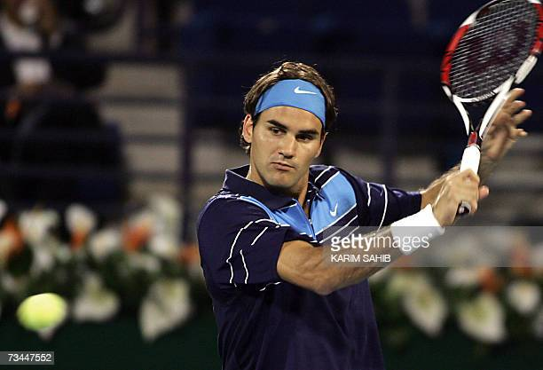 Swiss player Roger Federer returns the ball to Italy's Daniele Bracciali during their ATP Dubai Duty Free Open tennis match 28 February 2007 AFP...
