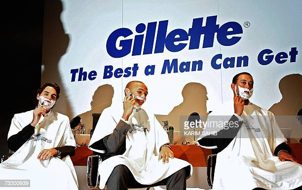 Swiss tennis player Roger Federer French football player Thierry Henry and US gofer Tiger Woods take part in promotion for US razor giant Gillette 04...
