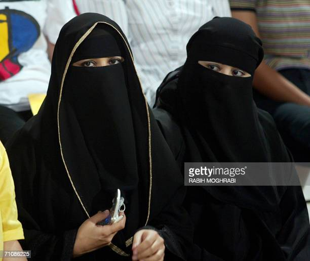 TO GO WITH AFP STORY BY LYDIA GEORGI LIFESTYLEFASHIONGULFUAE Emirati women wear the traditional traditional abaya the long black robes worn by women...