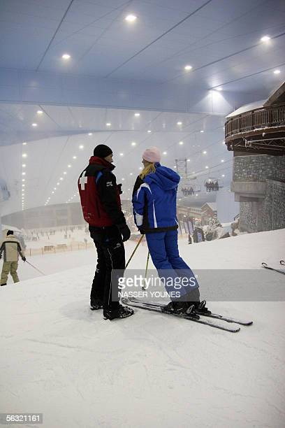 Visitors enjoy skiing as it officially started 02 December 2005 at Dubai's new indoor ski resort a manmade mountain scene as big as three football...
