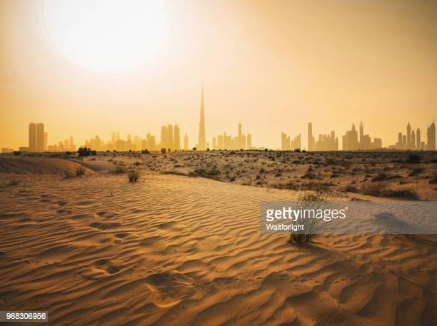 dubai urban skyline in desert - desert stock pictures, royalty-free photos & images