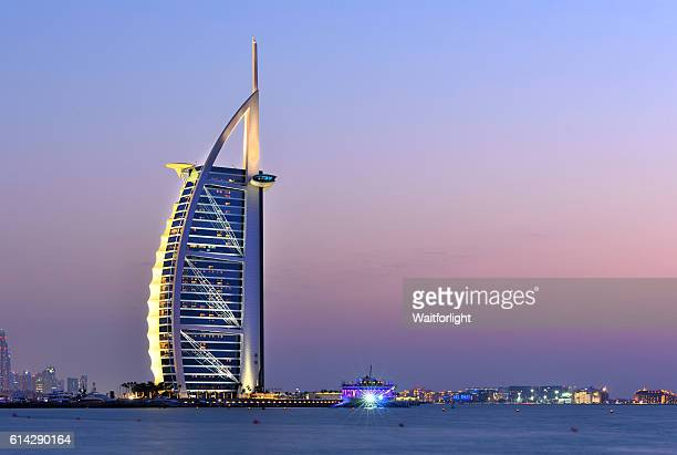 Dubai's beach with Burj Al Arab hotel at sunset