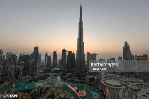 Dubai's fountain show resumes beneath the Burj Khalifa tower on June 5 as the Gulf emirate emerges from a lockdown imposed due to the COVID19 pandemic