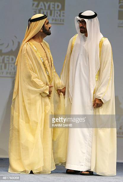 Dubai's ruler Sheikh Mohammad bin Rashed alMaktoum who is also vice president and prime minister of the United Arab Emirates speaks to Sheikh...
