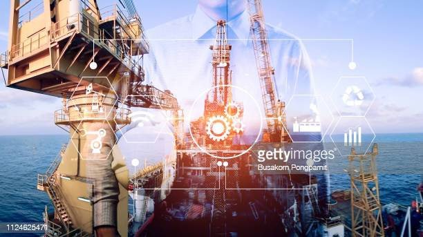 duble exposure engineer to mangae business of oil refinery industry plant from aerial view in oil refinery industry or oil industrial with technology icons concept - marine engineering stock pictures, royalty-free photos & images