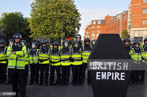 Dublin 18 May 2011 Irish Garda form a police line during a protest in Dublin against the visit of Britain's Queen Elizabeth II