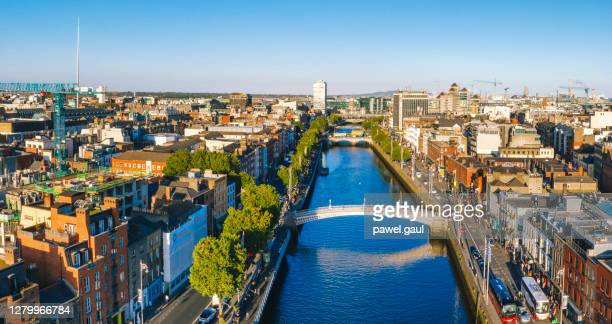 dublin aerial with ha'penny bridge and liffey river during sunset in dublin, ireland - downtown stock pictures, royalty-free photos & images