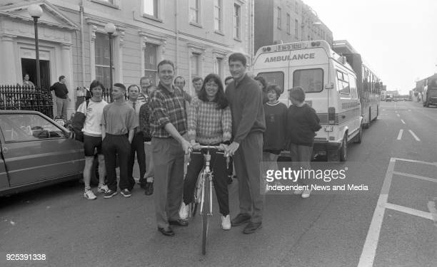 Dublin Football Stars Keith Barr and Mick Galvin are pictured as they give a shoveoff to Catherine McDonnell of the Nursing staff of Temple Street...
