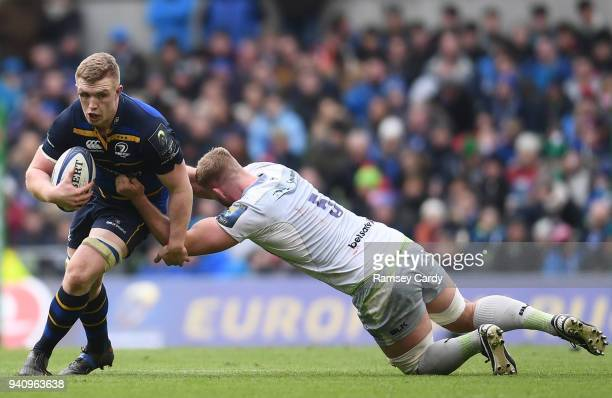 Dublin Ireland 1 April 2018 Dan Leavy of Leinster is tackled by George Kruis of Saracens during the European Rugby Champions Cup quarterfinal match...