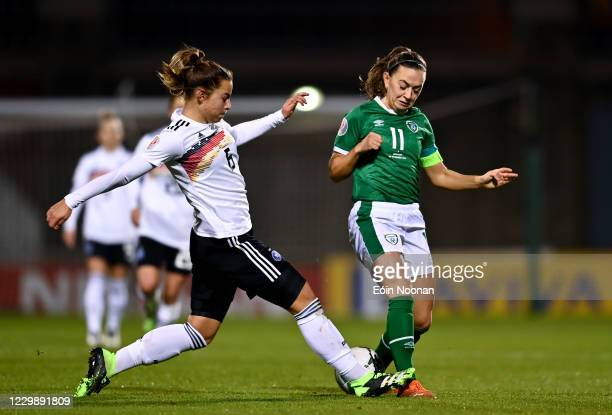 Dublin , Ireland - 1 December 2020; Katie McCabe of Republic of Ireland in action against Marina Hegering of Germany during the UEFA Women's EURO...