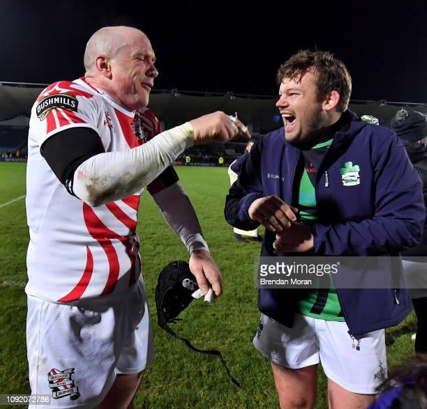 Dublin Ireland 1 February 2019 Hugh Vyvyan of England Legends left and Denis Fogarty of Ireland Legends after the Stuart Mangan Memorial Cup match...