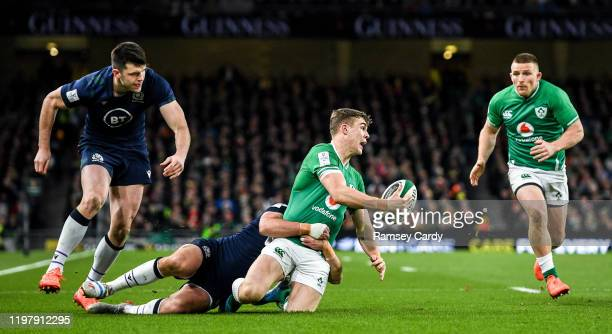 Dublin Ireland 1 February 2020 Garry Ringrose looks to offload to his Ireland teammate Andrew Conway while being tackled by Ali Price of Scotland...