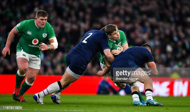 Dublin Ireland 1 February 2020 Garry Ringrose of Ireland is tackled by Fraser Brown and Rory Sutherland of Scotland during the Guinness Six Nations...
