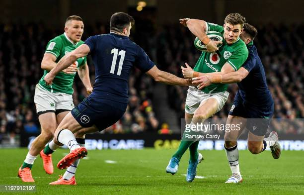 Dublin Ireland 1 February 2020 Garry Ringrose of Ireland is tackled by Blair Kinghorn left and Ali Price of Scotland during the Guinness Six Nations...