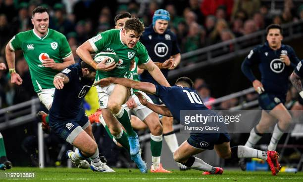 Dublin Ireland 1 February 2020 Garry Ringrose of Ireland is tackled by Fraser Brown left and Adam Hastings of Scotland during the Guinness Six...