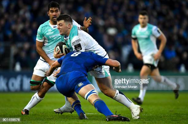 Dublin Ireland 1 January 2018 Denis Coulson of Connacht is tackled by Max Deegan of Leinster during the Guinness PRO14 Round 12 match between...