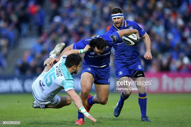 Dublin Ireland 1 January 2018 James Lowe of Leinster is tackled by Tiernan OHalloran of Connacht during the Guinness PRO14 Round 12 match between...