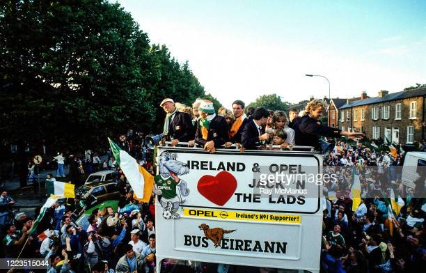 Dublin Ireland 1 July 1990 Members of the Republic of Ireland squad including manager Jack Charlton Frank Stapleton and John Byrne are cheered by...