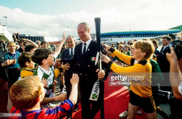 Dublin Ireland 1 July 1990 Republic of Ireland manager Jack Charlton is greeted by young foorballers on his squad's arrival home for a homecoming...