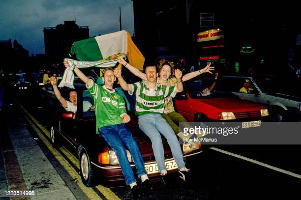 Dublin , Ireland - 1 July 1990; Republic of Ireland supporters cheer on their team as they are brought by open top bus from Dublin Airport to College...