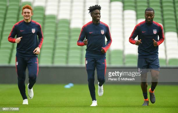 Dublin Ireland 1 June 2018 Tim Weah centre with teammates Josh Sargent left and Shaq Moore during a USA training session at the Aviva Stadium in...