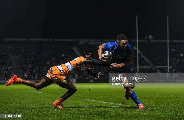 Dublin Ireland 1 March 2019 Adam Byrne of Leinster is tackled by Rabz Maxwane of Toyota Cheetahs on his way to scoring his side's second try during...